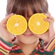Girl with oranges - Stock Photo