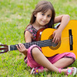 Girl with a guitar — Stock Photo #9625116