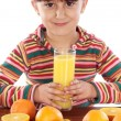 Child with oranges - Stock Photo