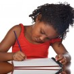 Adorable girl studying — Stock Photo