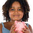 Adorable African girl with pink piggy bank - Stock Photo