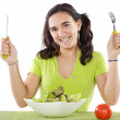 Adolescent eating a salad — Stock Photo
