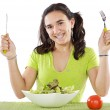 Adolescent eating a salad - Stock Photo