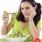 Girl eating salad. I do not like anything! — Stock Photo #9625392