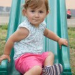 Girl playing on slide — Stockfoto #9625479