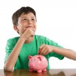 Child thinking what to buy with their savings — Stock Photo #9625581