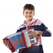 Adorable child playing red accordion — Stock Photo #9625669