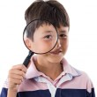 Kid with magnifying glass — Stock Photo #9625671