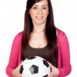 Beautiful brunette girl with soccer ball — Stock Photo #9626158