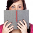 Brunette girl with a reader — Stock Photo #9626163