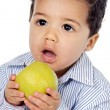 Small baby eating an apple — Stock Photo
