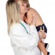 Pediatrician woman with a scared baby — Stock Photo