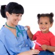 Pediatrician with a beautiful baby girl - Stok fotoğraf