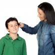 Mother pulling her child's ear for being naughty — Stock Photo #9626390