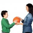 Mother handing a basketball to his son — Stock Photo #9626395