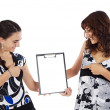 Two casual teenagers whit clipboard — Stock Photo #9626475