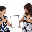 Two casual teenagers whit clipboard — Stock Photo