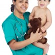 Adorable doctor with a baby in her arms — Stock Photo #9626491