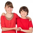 Stock Photo: Adorable preteen girl and little gir in red