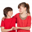 Adorable preteen girl and little gir in red — Stock Photo