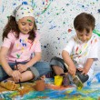 Children playing with painting — Stock Photo #9626574