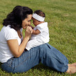 Mother playing with her daughter — Stock Photo #9626584