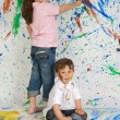Children playing with painting - Stock Photo