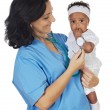 Nurse holding baby — Stock Photo