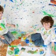 Children playing with painting — Stock fotografie #9626596