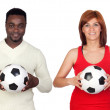 Beautiful redhead girl and attractive african men with a soccer — Stock Photo