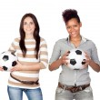 Stock Photo: Two pretty girls with a soccer ball