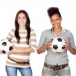 Stockfoto: Two pretty girls with a soccer ball