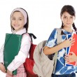 Two girls students returning to school - Stock Photo