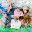 Stock Photo: Friends playing with painting