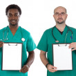 Medical team with clipboard in blank — Stock Photo