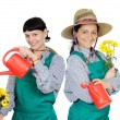 Two woman dressed gardener — Stock Photo