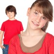 Adorable preteen girl and little gir in red — Stock Photo #9627242