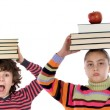 Adorable children with many books and apple on the head — Stok fotoğraf
