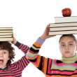 Adorable children with many books and apple on the head — Stock Photo
