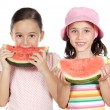 Stock Photo: Two beautiful girls eating watermelon