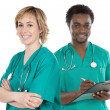 Couple of young doctors — Stock Photo #9627630
