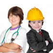 Two children with clothes of workers — Stock Photo