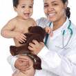 Nurse holding  baby - Stock Photo