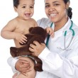 Stock Photo: Nurse holding baby