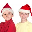 Funny child and smiling preteen with Santa Claus hat — Stock Photo #9628337