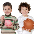 Two happy children with moneybox savings — Stock Photo #9628353