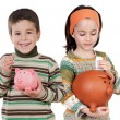Two happy children with moneybox savings — Stock Photo