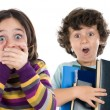 Surprised girl and a boy with many books falling — Stockfoto