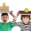Adorable children with many books and apple on the head — Stock Photo #9628370