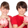 Two brothers with money-box — Stock Photo